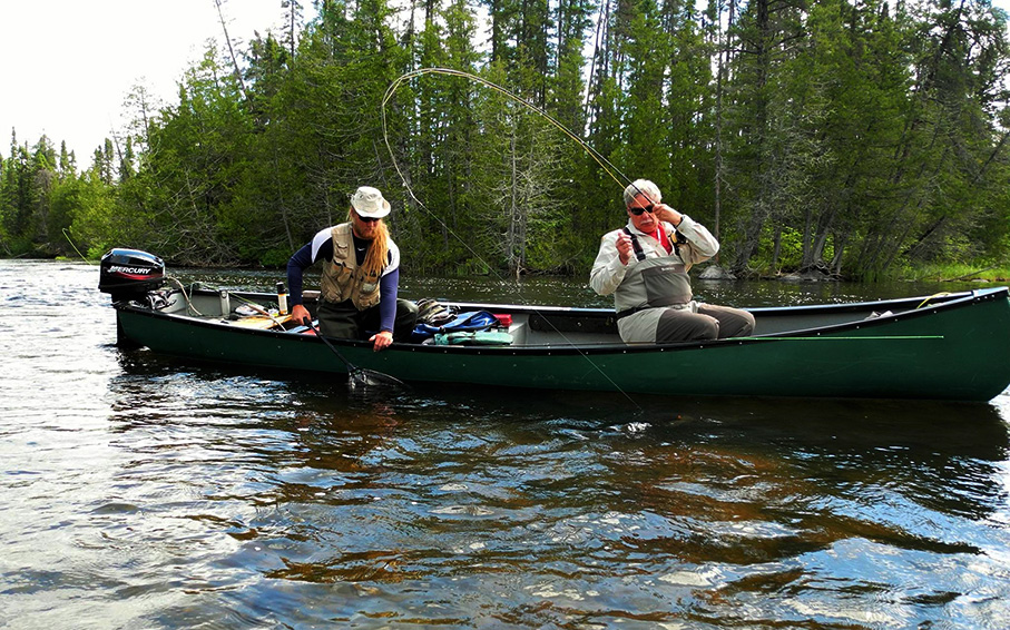 Fly fishing from canoe on Esnagami River